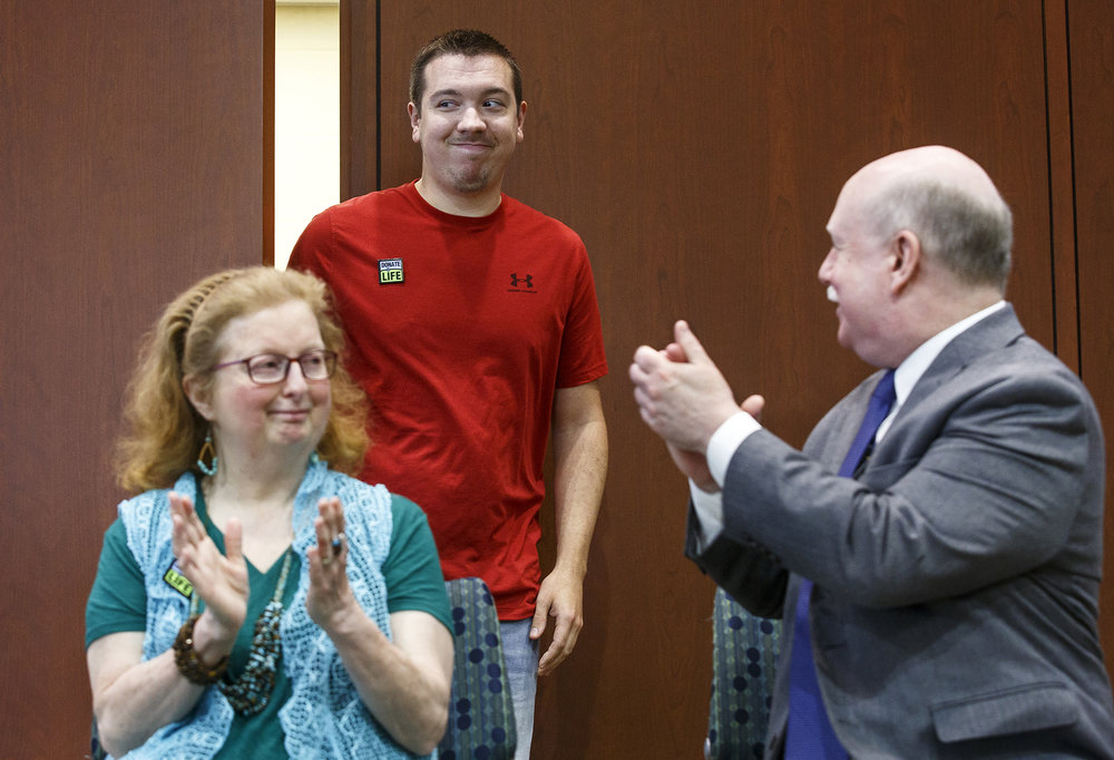 Ian Robertson is introduced during a news conference announcing a kidney transplant chain that took place last year involving four donors and four recipients Wednesday, June 20, 201 8 at the Memorial Center for Innovation and Learning in Springfield, Ill. Deborah Kunath, left, received a new kidney from Misty Shaw, the first transplant in the chain. Kunath's husband, Robert, right, in turn donated a kidney to Robertson. [Rich Saal/The State Journal-Register]