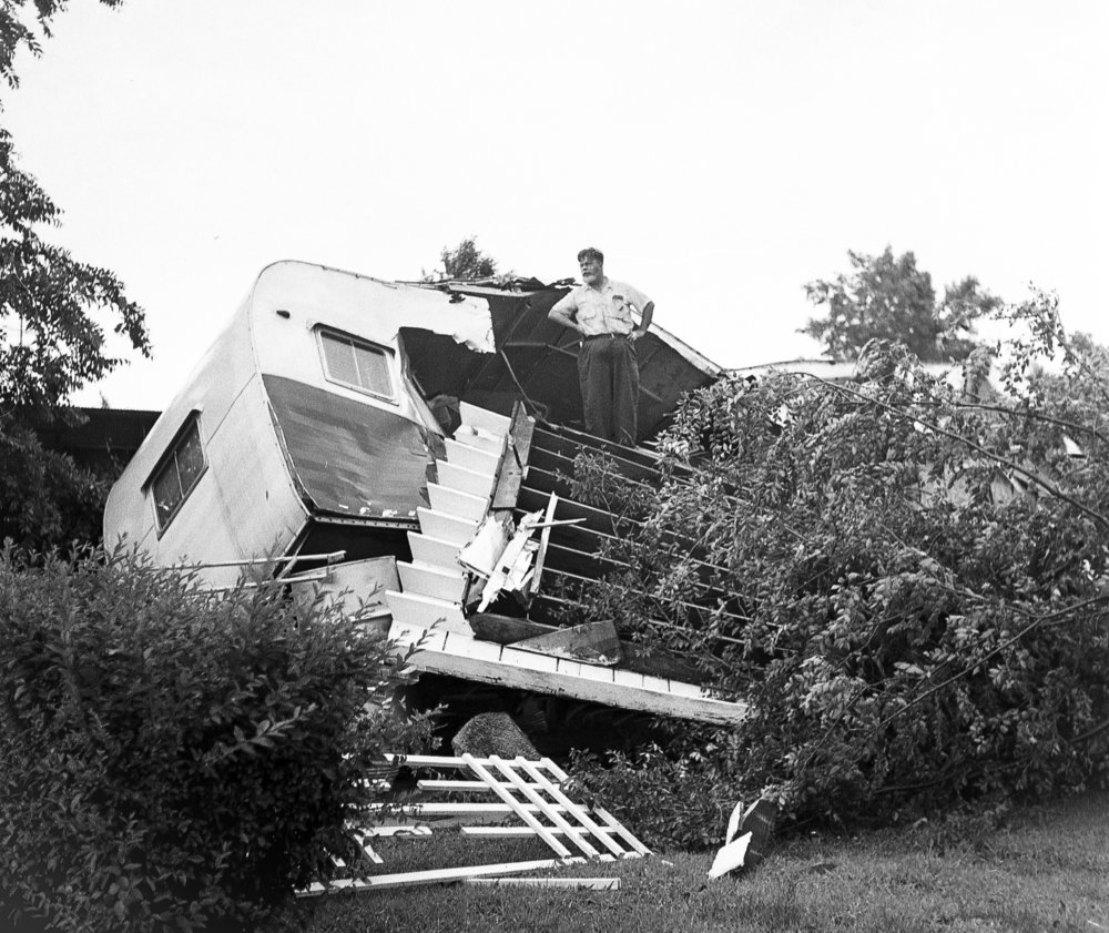 An unidentified man surveys damage to his wrecked home in the Morris Trailer Courts at 2130 E. Ash St. June 14, 1957. The storm caused more than $1 million in damages, killed three people, injured more than 50 and destroyed 20 to 25 homes. File/The State Journal-Register