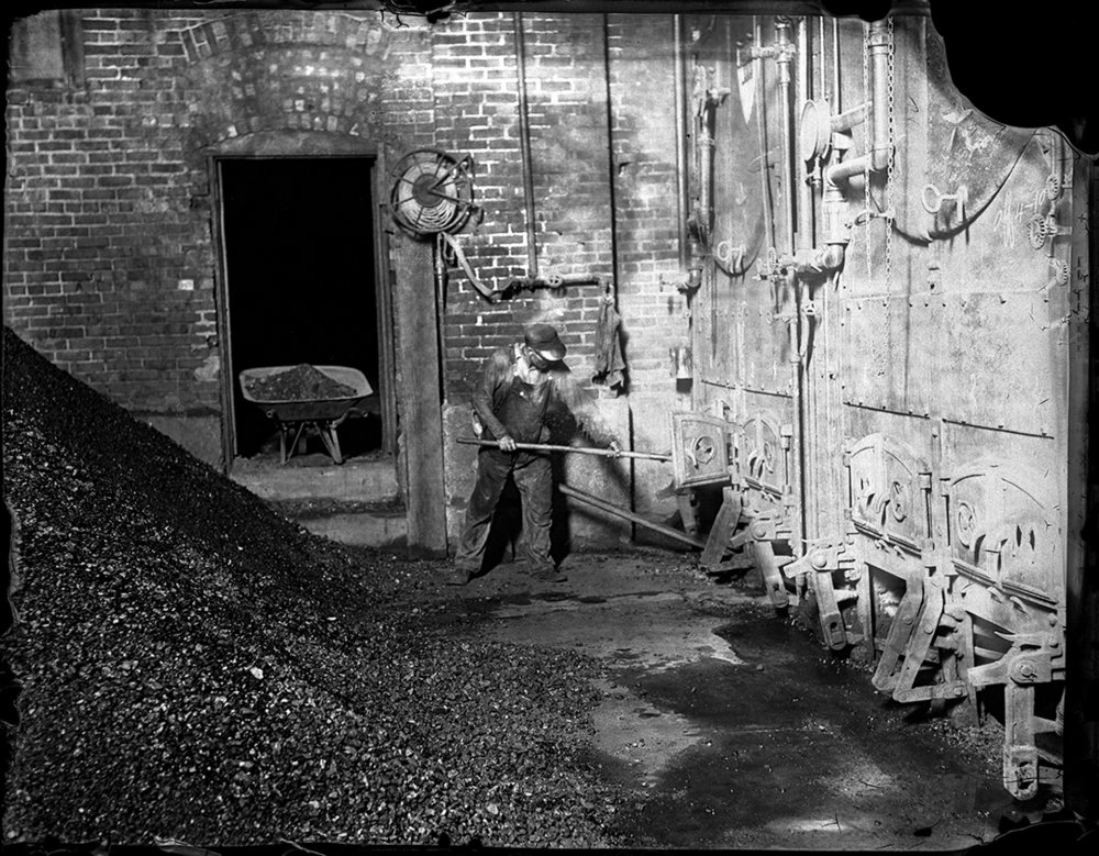 Charlie Fleming stoking furnaces with coal in C.I.P.S. ice house at Tenth and Edwards. Illinois State Journal glass plate negative/Sangamon Valley Collection at Lincoln Library. All Rights Reserved, The State Journal-Register. C-98-843 negative #423 (See also C-98-765 showing Clark Fleming in ice storage room of the plant, images published together July 12, 1936.)