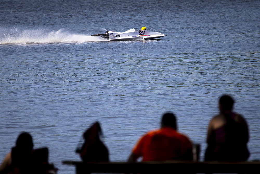 Spectators take in the view as the hydroplane boats competing in this weekend's U.S. Title Series stop make test laps on Lake Springfield at Bridgeview Park in preparations for this weekend's racing, Friday, June 29, 2018, in Springfield, Ill. Racing action continues on Saturday and Sunday from Noon to 5 p.m. at Bridgeview Park. [Justin L. Fowler/The State Journal-Register]