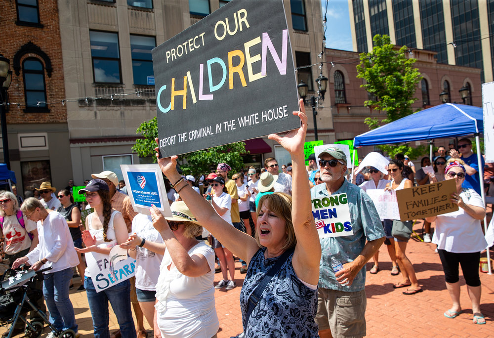 "Roxanne Gregory, of Staunton, Ill., shows her support of immigrant children during the ""Families Belong Together"" rally on the Old State Capitol Plaza, Saturday, June 30, 2018, in Springfield, Ill. ""I'm afraid we're in some dangerous times right now,"" said Gregory. ""I'm afraid that if we don't stand up we're gonna look back one day and see a lost opportunity.""  [Justin L. Fowler/The State Journal-Register]"