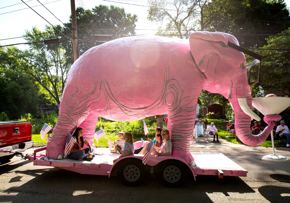 The Kent family's famous pink elephant provides some shade for its passengers in the Village of Jerome's July 4th parade Wednesday, July 4, 2018 in Jerome, Ill. [Rich Saal/The State Journal-Register]