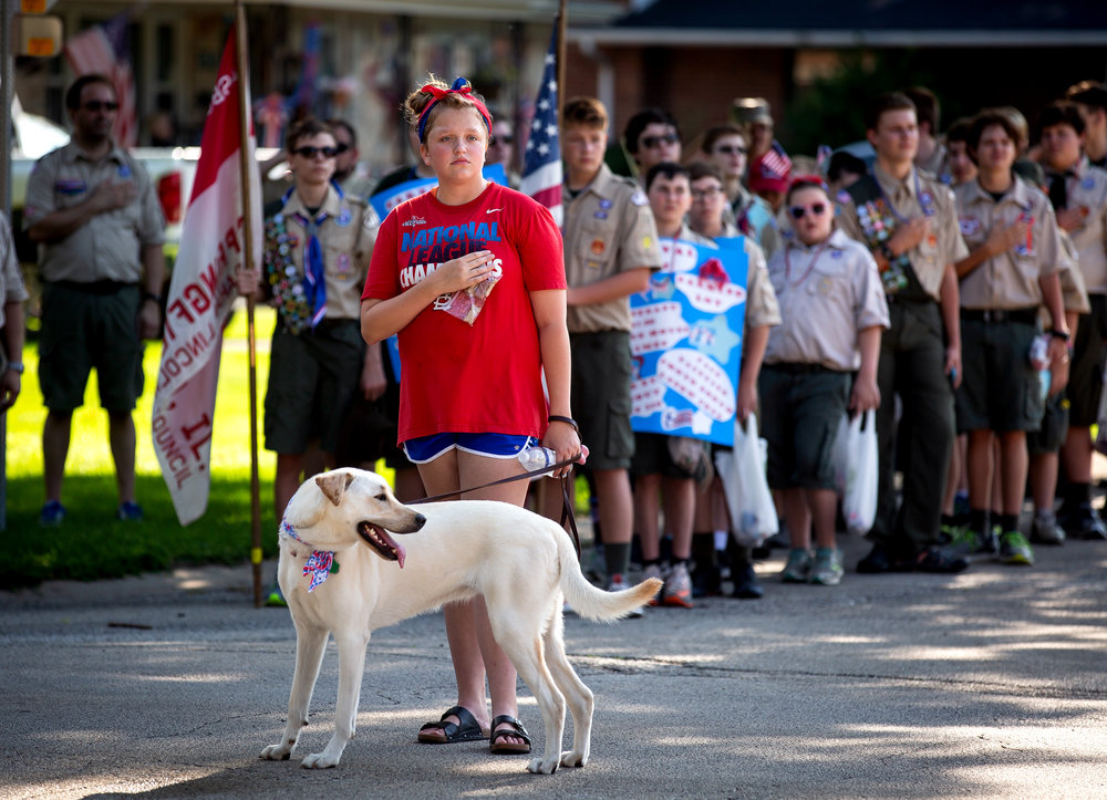 Tally Martin and her dog Stella Rose pause for the playing of the national anthem at the start of the Village of Jerome's July 4th parade Wednesday, July 4, 2018 in Jerome, Ill. [Rich Saal/The State Journal-Register]