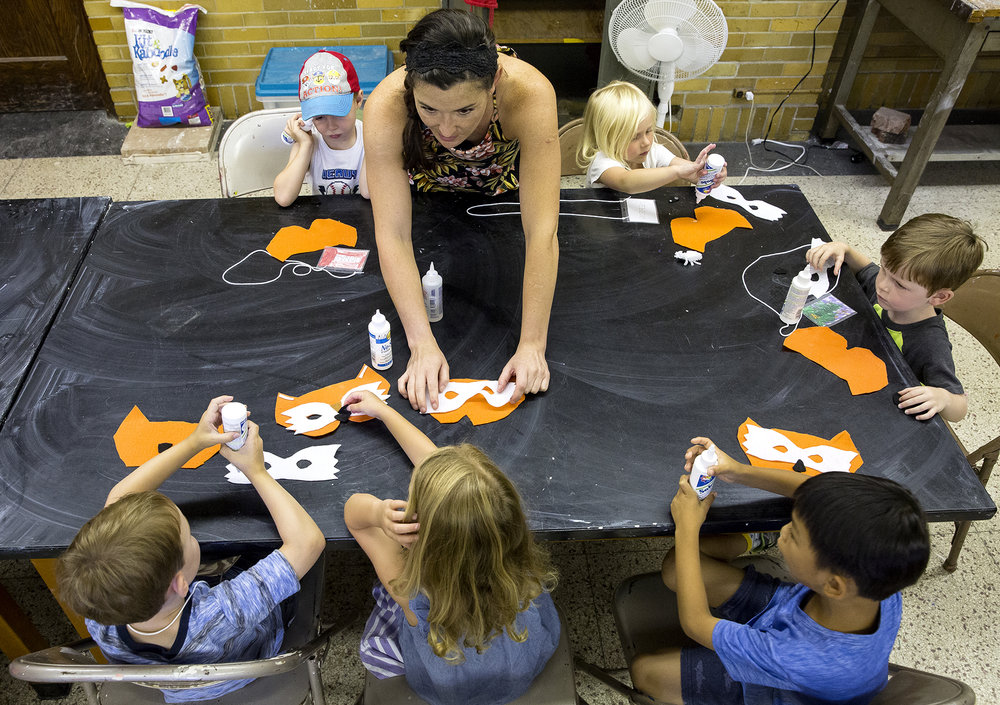 Kate Kutmas keeps a group of 4 and 5 year-olds focused on making fox masks during a Springfield Art Association summer art camp Tuesday, July 10, 2018. During the week-long camp the students will make masks out of clay, paper, felt and recycled materials using a room in Dawson Hall on the campus of Benedictine University in Springfield, Ill.[Rich Saal/The State Journal-Register]