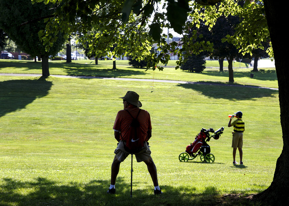 Rod Spears watches a group that includes his grandsons, Ryan and Drew Suhre, at the Drysdale Junior Golf Tournament Monday Tuesday,July 10, 2018 at Bergen Golf Course in Springfield, Ill.[Rich Saal/The State Journal-Register]