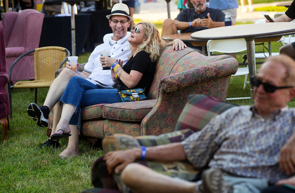 "Kurt Sames and Sue Ellen Busby laugh as they listen to music on the lawn of the Old State Capitol during the ""Amaranth Apple"" Music & Food Fest Friday, July 13, 2018. The festival continues Saturday with free admission for guests under 12 years-old and $5 admission for everyone 13 years-old and up. [Ted Schurter/The State Journal-Register]"