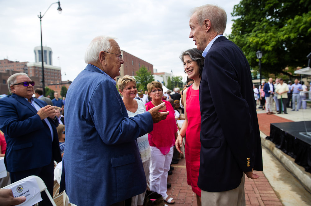 Former Gov. George Ryan, left, greets Gov. Bruce Rauner and First Lady Diana Rauner before ceremonies begin for the grand reopening of the Illinois Governor's Mansion on East Jackson Street in Springfield, Ill., Saturday, July 14, 2018. [Ted Schurter/The State Journal-Register]