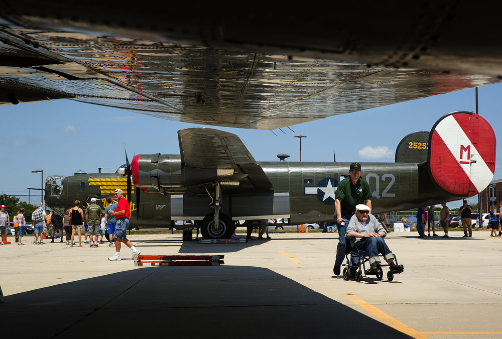 Patrons mill about a Consolidated B-24J Liberator on display during the Wings of Freedom Tour stop at Capital Airport Monday, July 23, 2018. [Ted Schurter/The State Journal-Register]