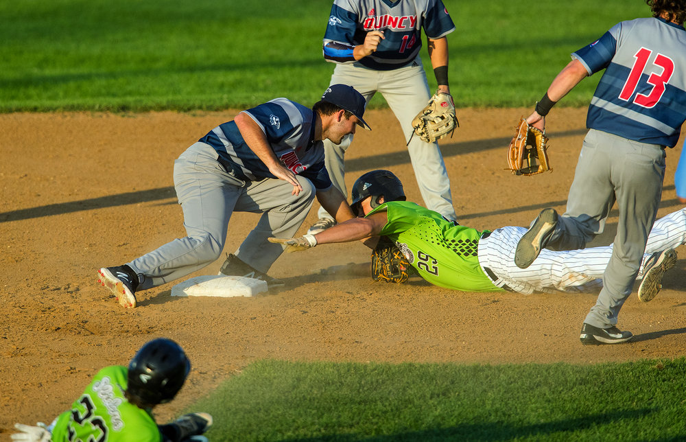Quincy's Kyle Crowl tags Springfield's Jordan Larson out at second base right after Springfield's Logan Stephens was caught in a rundown at Robin Roberts Stadium in Springfield, Ill., Thursday, July 26, 2018. [Ted Schurter/The State Journal-Register]