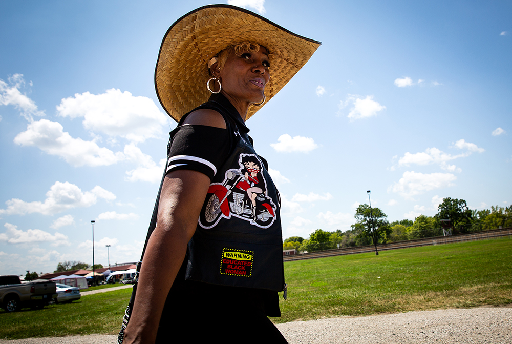 Cinda Turnbull of Champaign, walks through the mile track infield on opening day of the National Bikers Roundup Wednesday, Aug. 1, 2018 Illinois State Fairgrounds in Springfield, Ill. [Rich Saal/The State Journal-Register]