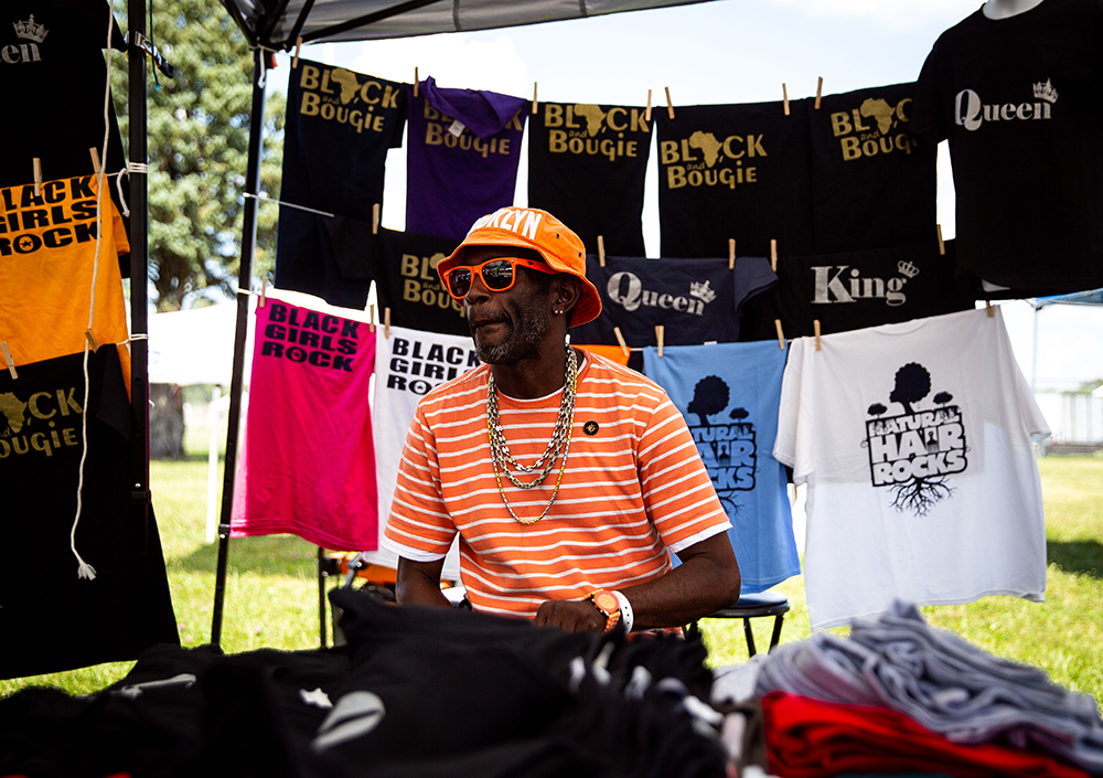 Shariff Allah from North Carolina sells t-shirts from a booth at the National Bikers Roundup Wednesday, Aug. 1, 2018 Illinois State Fairgrounds in Springfield, Ill. [Rich Saal/The State Journal-Register]