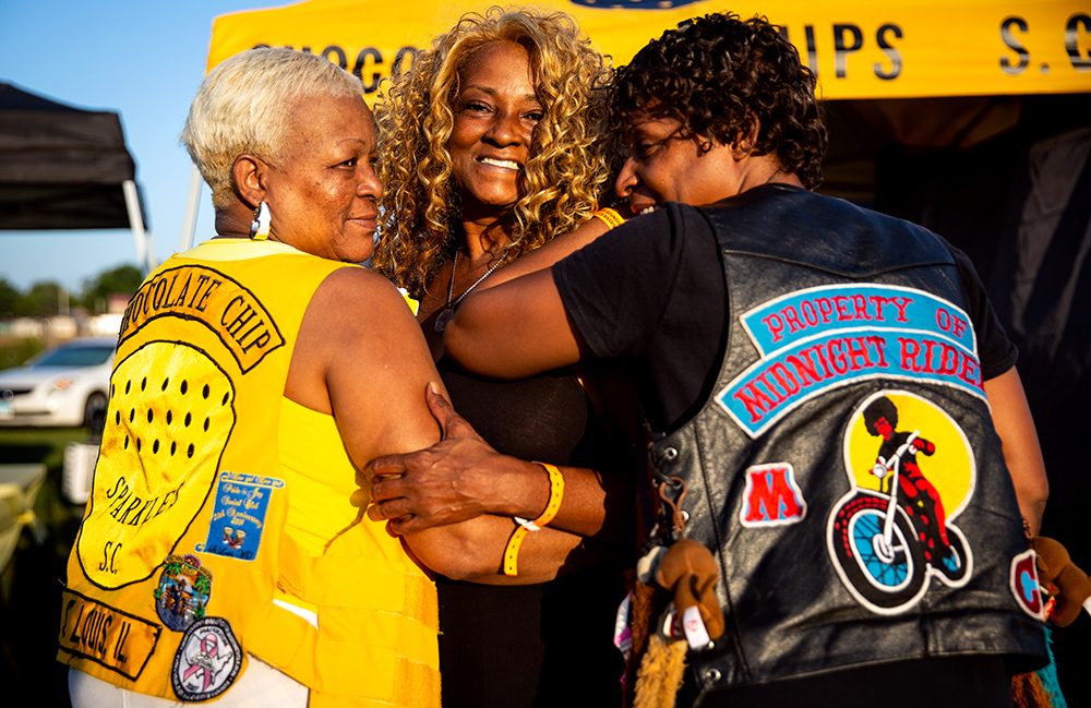 Proud of their club's colors, Jennetta Greer, left, and Melessa Baxtron pose with their friend, Diane Steward, center, at the National Bikers Roundup Wednesday, Aug. 1, 2018 Illinois State Fairgrounds in Springfield, Ill. Greer and Baxtron are from East St.Louis and Steward is from St.Louis, Mo. [Rich Saal/The State Journal-Register]