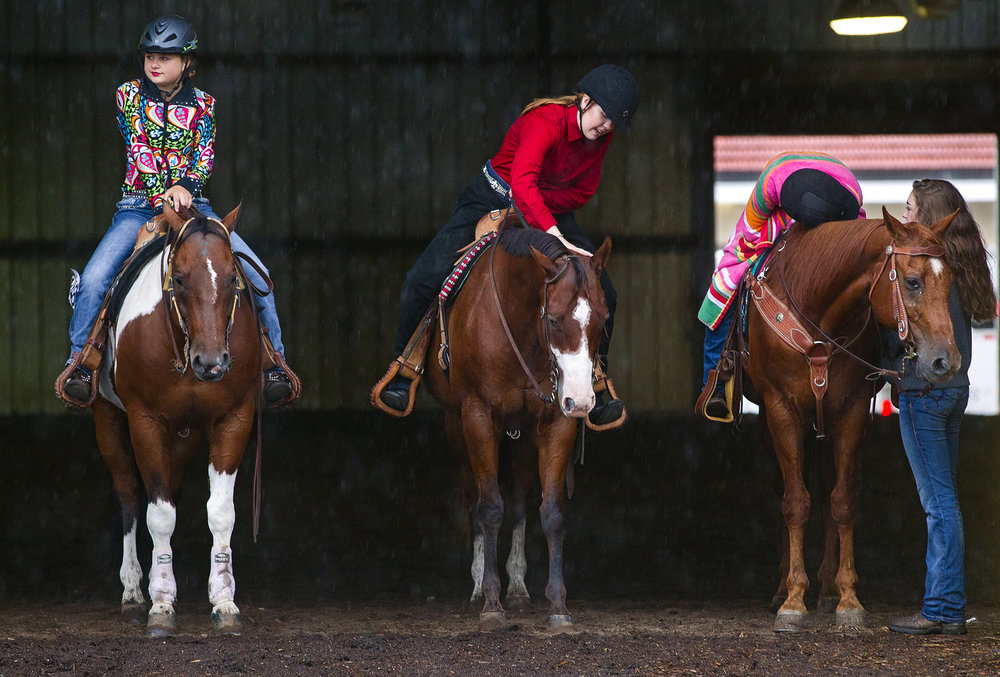 Waiting out the rain before competing in the Reigning competition at the Illinois State Fair Junior Department Horse Show at the Illinois State Fairgrounds are, from left, Hailey Bone, Emmaly Ragsdale, Emily Selby and Mia McAfoos. The week-long event ended Sunday. [Ted Schurter/The State Journal-Register]