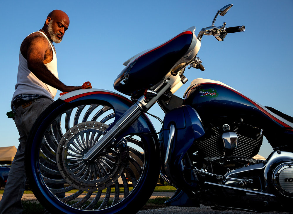 Tim Banks wipes the dust off his Harley Davidson Street Glide on the opening night of the National Bikers Roundup Wednesday, Aug. 1, 2018 at the Illinois State Fairgrounds in Springfield, Ill. The Roundup is the largest camping motorcycle rally in the country. [Rich Saal/The State Journal-Register]