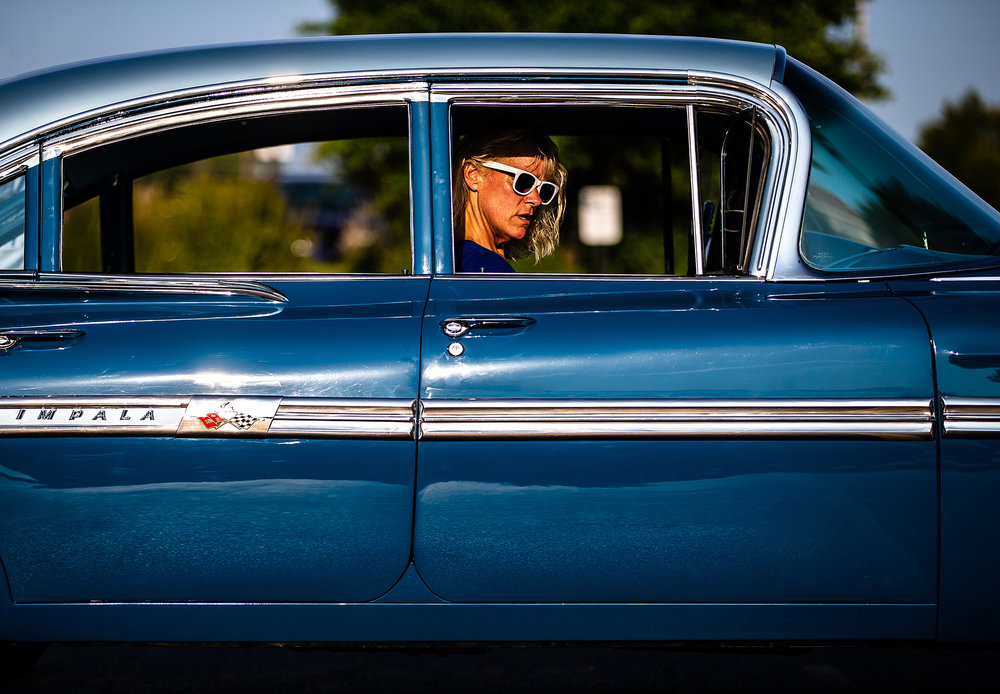 Shaun Stoutamyer arrives with her husband, Nick, in their award-winning 1959 Chevrolet Impala as they line up for the Abe Lincoln Super Cruise in the Horace Mann parking lot, Friday, Aug. 3, 2018, in Springfield, Ill. The car was originally bought brand new at the Bates Chevrolet dealership in Springfield by Nick Stoutamyer's grandfather and has been restored, but still has the original drivetrain with fifty-eight thousand miles on it. The cruise goes from the Horace Mann parking lot to Knights Action Park where on Saturday from 8 a.m. to 4 p.m. the Abe Lincoln Car Show Spectacular will be held.  [Justin L. Fowler/The State Journal-Register] [Justin L. Fowler/The State Journal-Register]