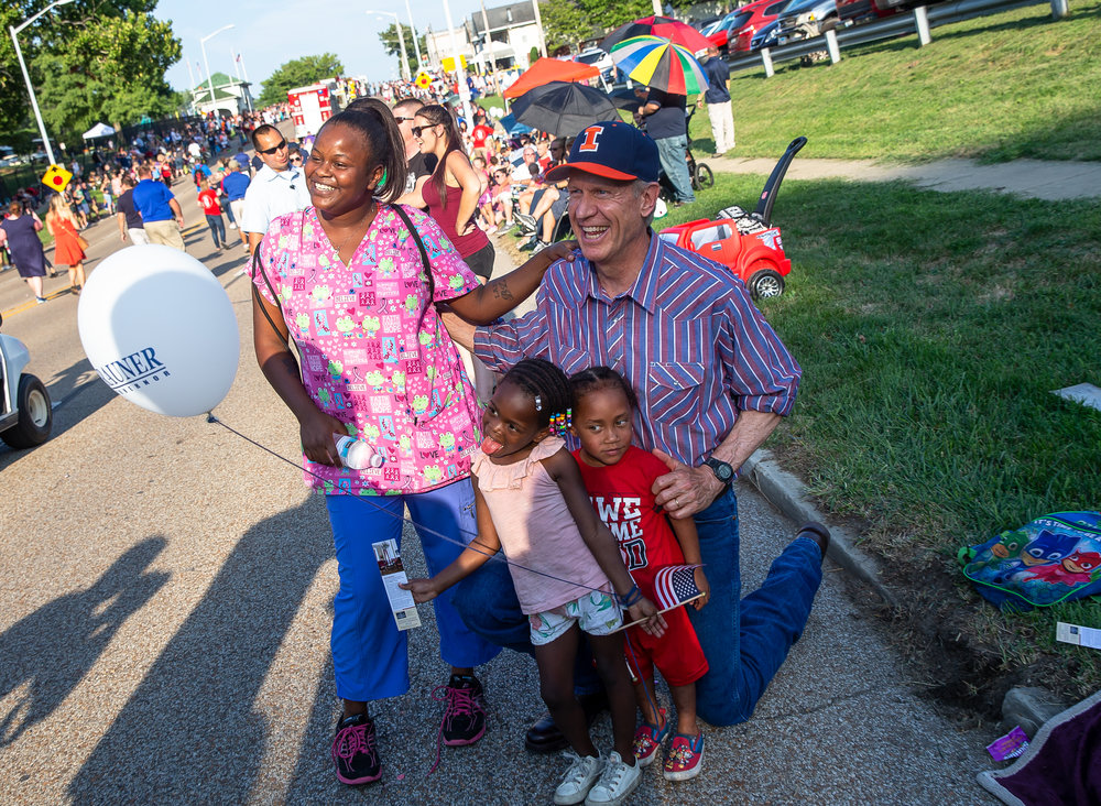 "Illinois Governor Bruce Rauner poses for a picture with Pas-Shune Thomas as he makes his way down Sangamon Avenue during the Illinois State Fair Twilight Parade, Thursday, Aug. 9, 2018, in Springfield, Ill.  ""If you don't vote for Rauner you don't know what you're doing,"" said Thomas. [Justin L. Fowler/The State Journal-Register]"