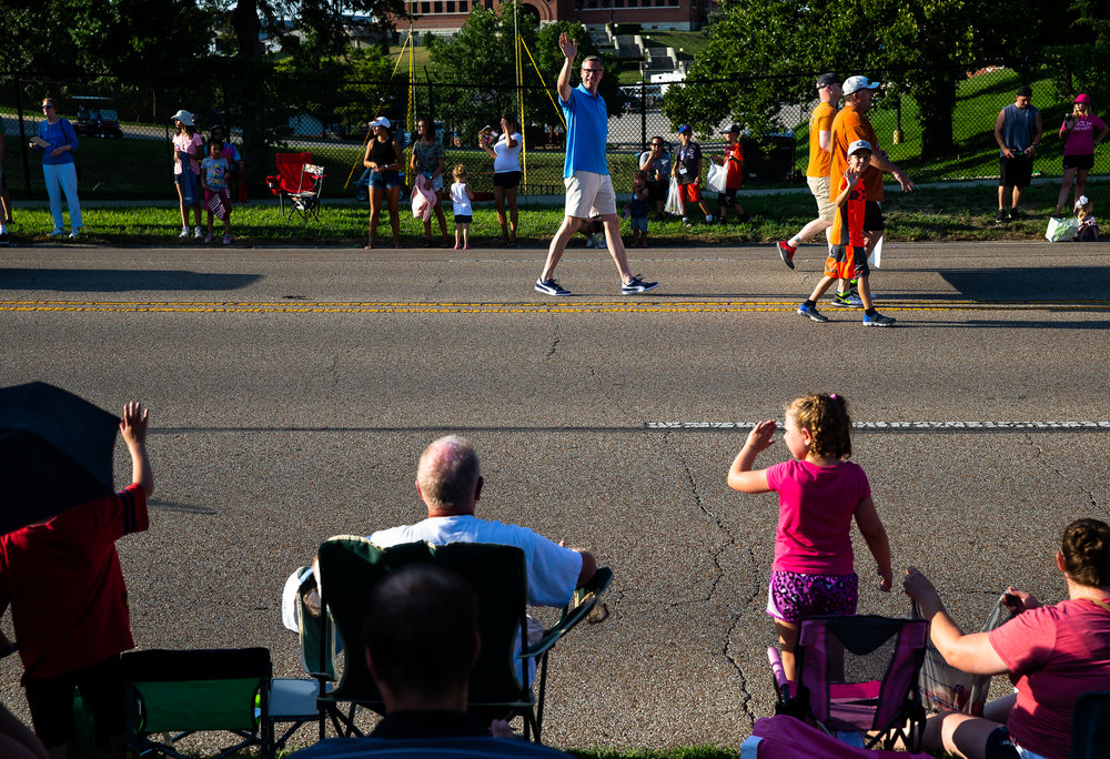 Illinois State Treasurer Mike Frerichs waves to the crowd as he marches down Sangamon Avenue during the Illinois State Fair Twilight Parade, Thursday, Aug. 9, 2018, in Springfield, Ill. [Justin L. Fowler/The State Journal-Register]
