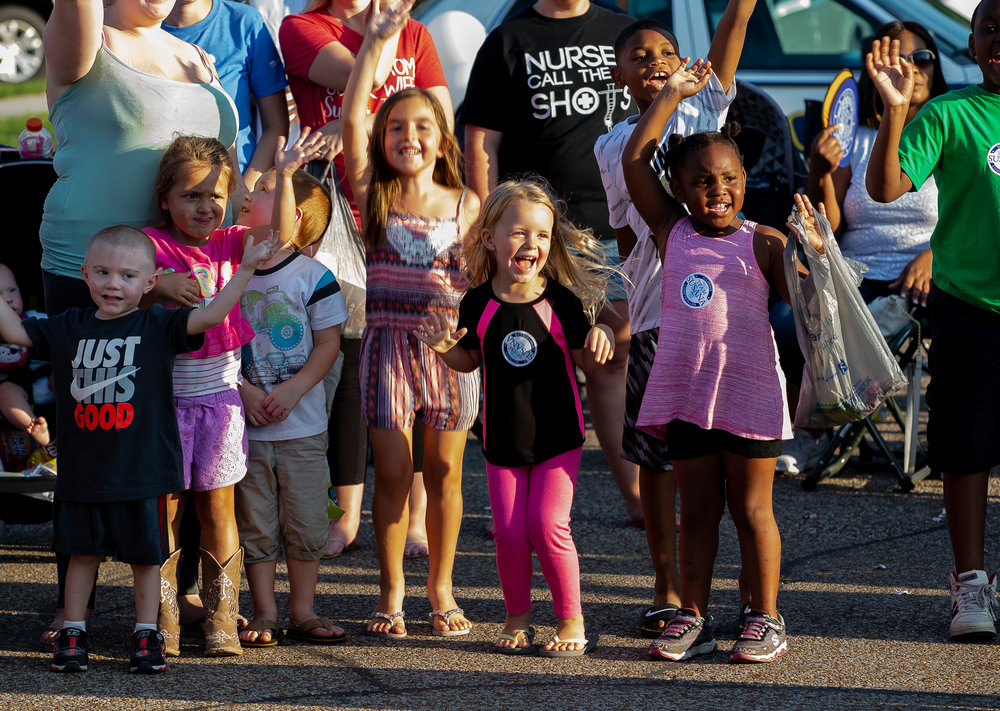 Children line up for their chance at the candy toss in front of the Main Gate to the Illinois State Fairgrounds during the Illinois State Fair Twilight Parade, Thursday, Aug. 9, 2018, in Springfield, Ill. [Justin L. Fowler/The State Journal-Register]