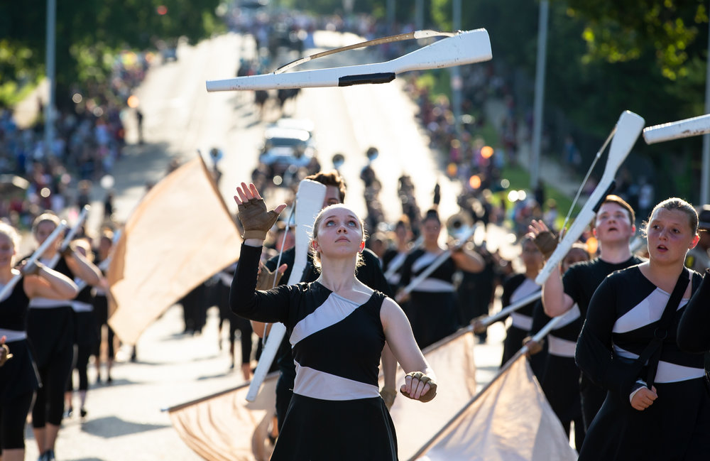 Members of the Normal Marching Band perform as they march down Sangamon Avenue during the Illinois State Fair Twilight Parade, Thursday, Aug. 9, 2018, in Springfield, Ill. [Justin L. Fowler/The State Journal-Register]