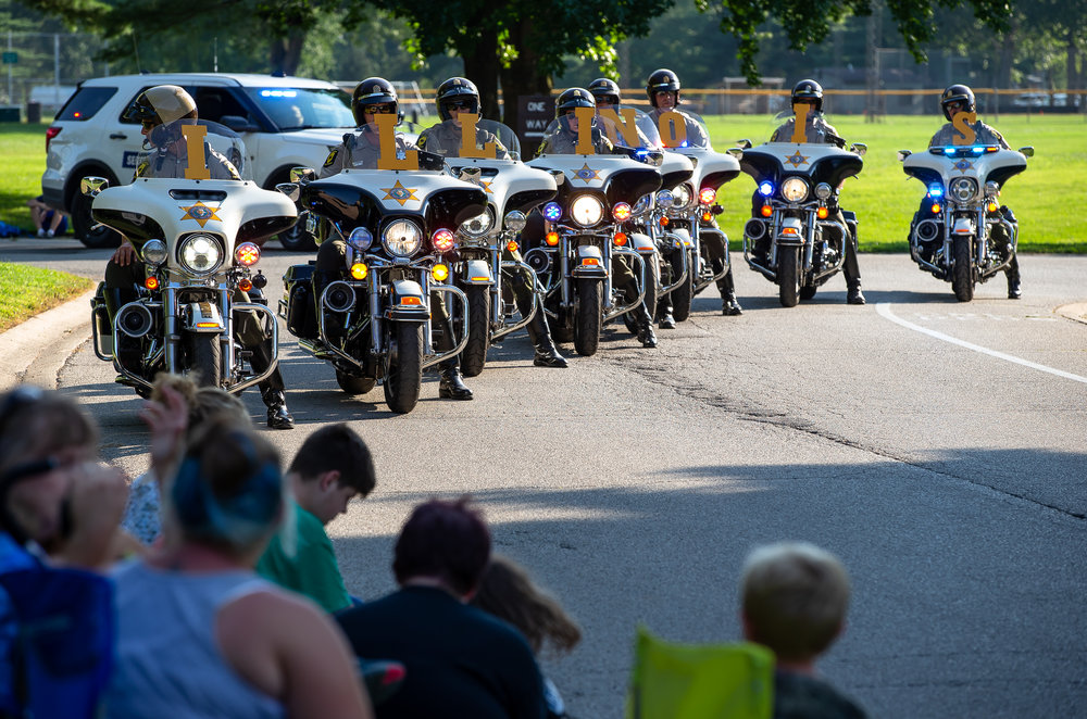 The Illinois State Police motorcycles lead out the Illinois State Fair Twilight Parade from Lincoln Park, Thursday, Aug. 9, 2018, in Springfield, Ill. [Justin L. Fowler/The State Journal-Register]
