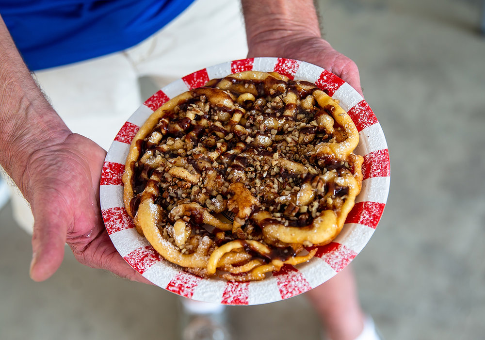 The turtle funnel cake from Paulette Keene of Paulette's Food Service from Pinckneyville, Ill., won the sweet category with her turtle funnel cake during the judging in Golden Abe's Fantastic Fair Food competition at the Lincoln Stage at the Illinois State Fair, Friday, Aug. 10, 2018, in Springfield, Ill. [Justin L. Fowler/The State Journal-Register]
