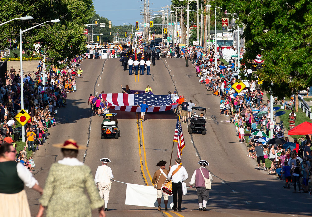 Members of the Illinois Elks Lodge 158 carry the American Flag along Sangamon Avenue as they head into the Illinois State Fairgrounds during the Illinois State Fair Twilight Parade, Thursday, Aug. 9, 2018, in Springfield, Ill. [Justin L. Fowler/The State Journal-Register]