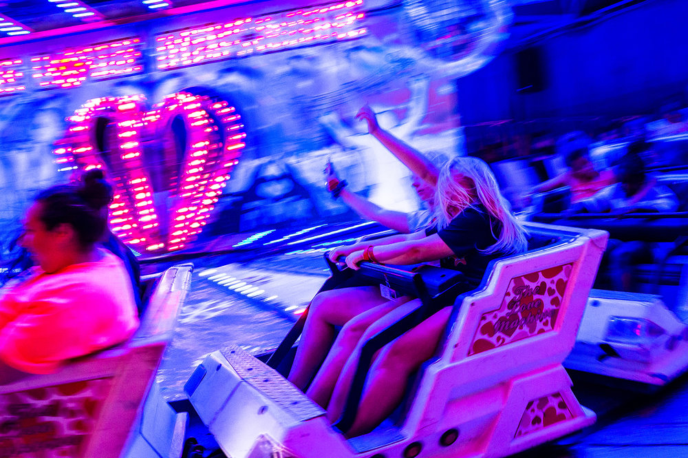 "Youth either pick to hold on tight or let loose while riding ""The Love Machine"" coaster in the Carnival Midway during the Illinois State Fair at the Illinois State Fairgrounds, Sunday, Aug. 12, 2018, in Springfield, Ill. [Justin L. Fowler/The State Journal-Register]"