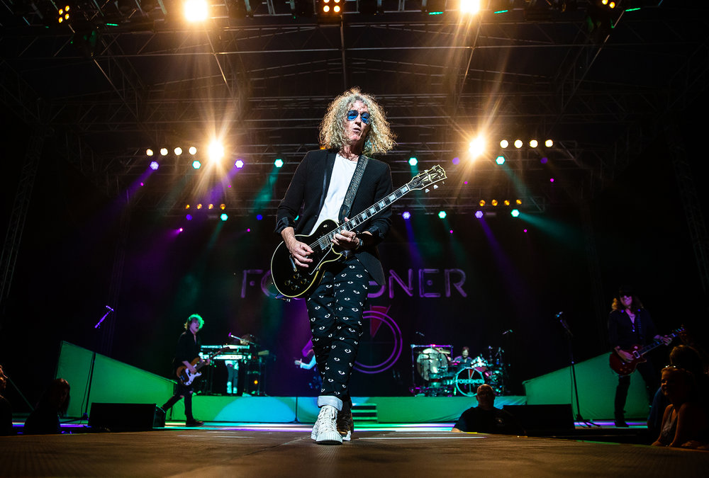 Guitarist Bruce Watson heads out on the platform for a solo while performing with Foreigner as the band plays on the Grandstand Stage during the Illinois State Fair at the Illinois State Fairgrounds, Sunday, Aug. 12, 2018, in Springfield, Ill. [Justin L. Fowler/The State Journal-Register]
