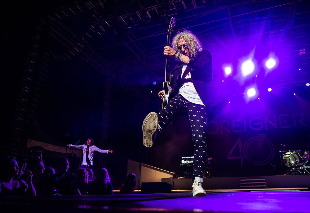 Guitarist Bruce Watson performs with Foreigner as the band plays on the Grandstand Stage during the Illinois State Fair at the Illinois State Fairgrounds, Sunday, Aug. 12, 2018, in Springfield, Ill. [Justin L. Fowler/The State Journal-Register]