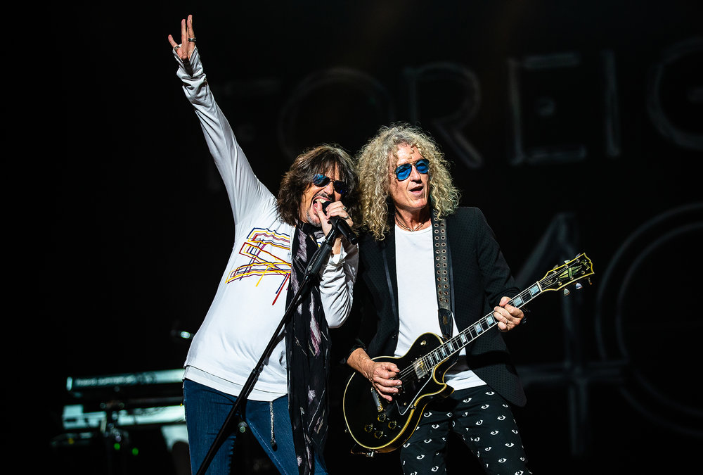 Lead singer Kelly Hansen, left, performs with guitarist Bruce Watson, right, with Foreigner as the band performs on the Grandstand Stage during the Illinois State Fair at the Illinois State Fairgrounds, Sunday, Aug. 12, 2018, in Springfield, Ill. [Justin L. Fowler/The State Journal-Register]