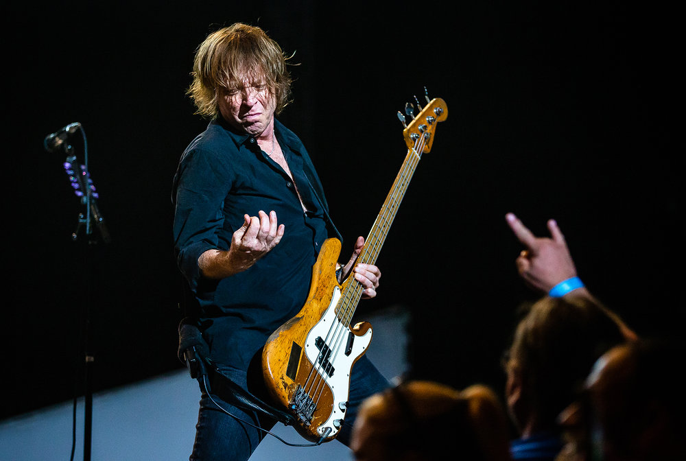Bassist Jeff Pilson performs with Foreigner as the band plays on the Grandstand Stage during the Illinois State Fair at the Illinois State Fairgrounds, Sunday, Aug. 12, 2018, in Springfield, Ill. [Justin L. Fowler/The State Journal-Register]