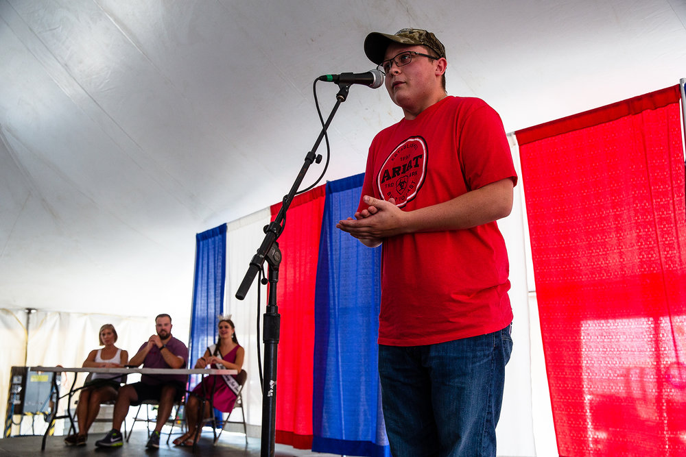 Andrew Metheney, of Georgetown, Ill., delivers a collection of hog calls to win the Hog Calling contest for the third year in a row during the Husband and Hog Calling contest inside the Ag Tent at the Illinois State Fairgrounds, Sunday, Aug. 12, 2018, in Springfield, Ill. [Justin L. Fowler/The State Journal-Register]