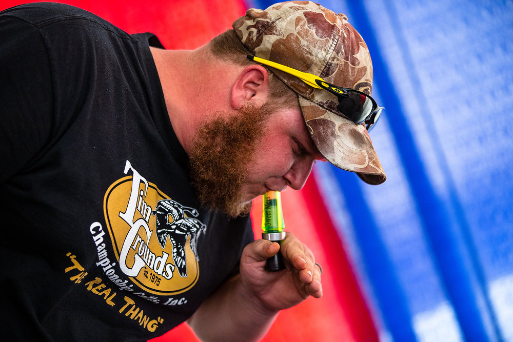 Cody Covalesky, of Greenville, Ill., won the first ever Duck Calling Contest using a duck call his late mother gave to him ten years ago during the Husband and Hog Calling contest inside the Ag Tent at the Illinois State Fairgrounds, Sunday, Aug. 12, 2018, in Springfield, Ill. [Justin L. Fowler/The State Journal-Register]