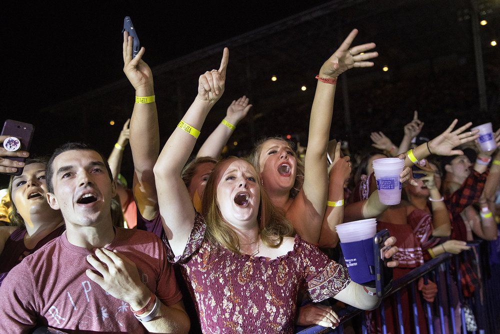 Fans cheer for country artist Luke Combs as he performs at the Grandstand during the Illinois State Fair Tuesday, Aug. 14, 2018. [Ted Schurter/The State Journal-Register]