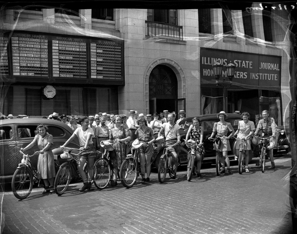 People on bicycles in front of Illinois State Journal building, 313 S. Sixth Street, August 29, 1939. File/The State Journal-Register 