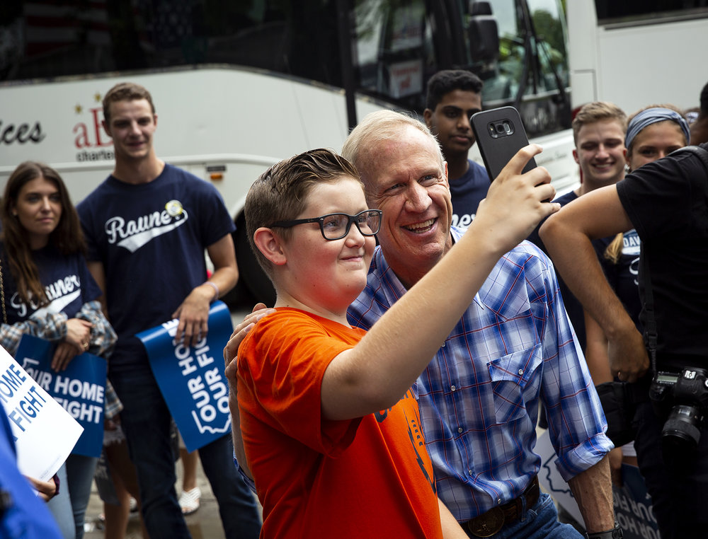 Gov. Bruce Rauner poses for a picture with Will Feurer at the Governor's Day event Wednesday, Aug. 15, 2018 at the Illinois State Fair in Springfield, Ill. [Rich Saal/The State Journal-Register]