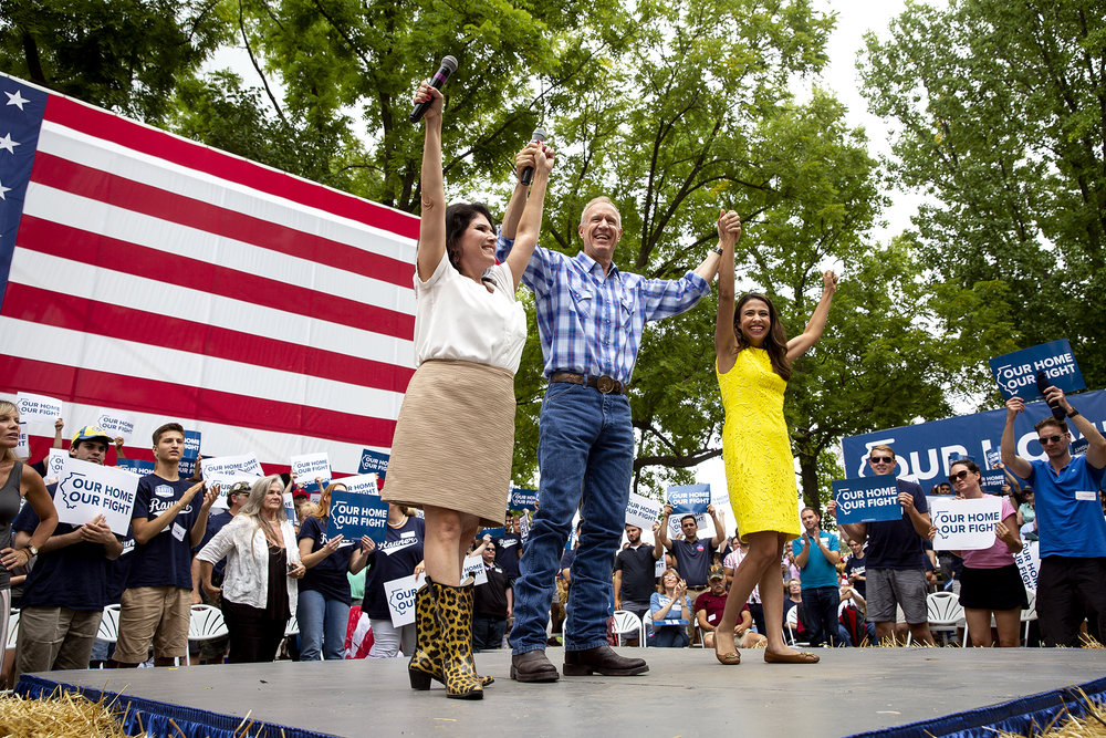 Gov. Bruce Rauner wraps up the Governor's Day program with Lt. Gov. Evelyn Sanguinetti, left, and candidate for attorney general, Erika, Harold Wednesday, Aug. 15, 2018 at the Illinois State Fair in Springfield, Ill. [Rich Saal/The State Journal-Register]