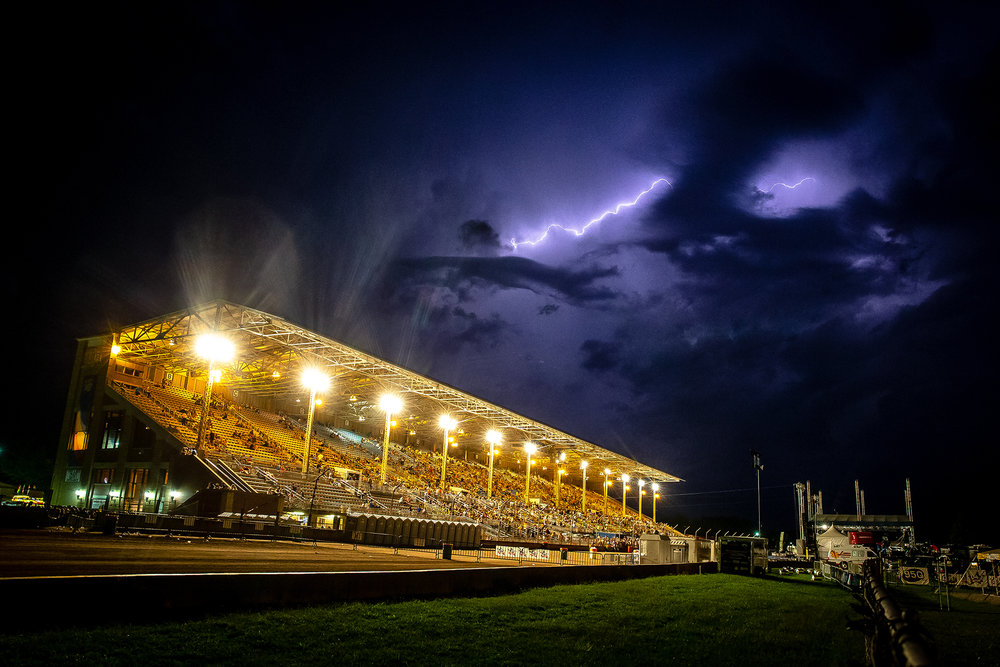 Lightning fills the skies as concert goers take to shelter as a severe thunderstorm approaches from the north over the Grandstand during the Illioins State Fair at the Illinois State Fairgrounds, Thursday, Aug. 16, 2018, in Springfield, Ill. [Justin L. Fowler/The State Journal-Register]