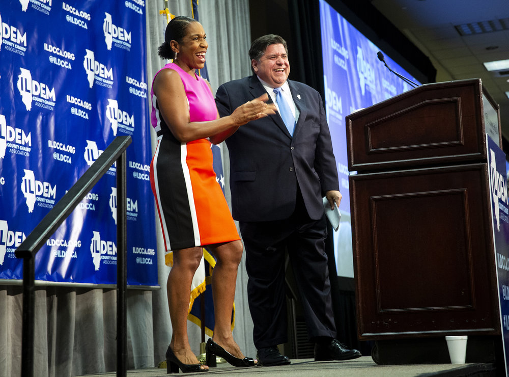 J.B. Pritzker is introduced by Rep. Juliana Stratton, D-Chicago, his running mate, at the Illinois Democratic County ChairsÕ Association brunch Thursday, Aug. 16, 2018 at the Crowne Plaza in Springfield, Ill. [Rich Saal/The State Journal-Register]
