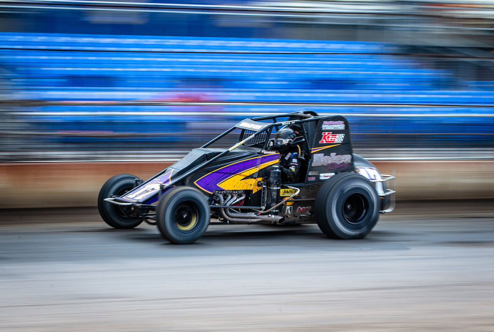 Chris Windom takes the lead on lap 92 over Kevin Thomas Jr. on his way to winning the USAC Silver Crown Bettenhausen 100 on the Springfield Mile during the Illinois State Fair at the Illinois State Fairgrounds, Saturday, Aug. 18, 2018, in Springfield, Ill. [Justin L. Fowler/The State Journal-Register]