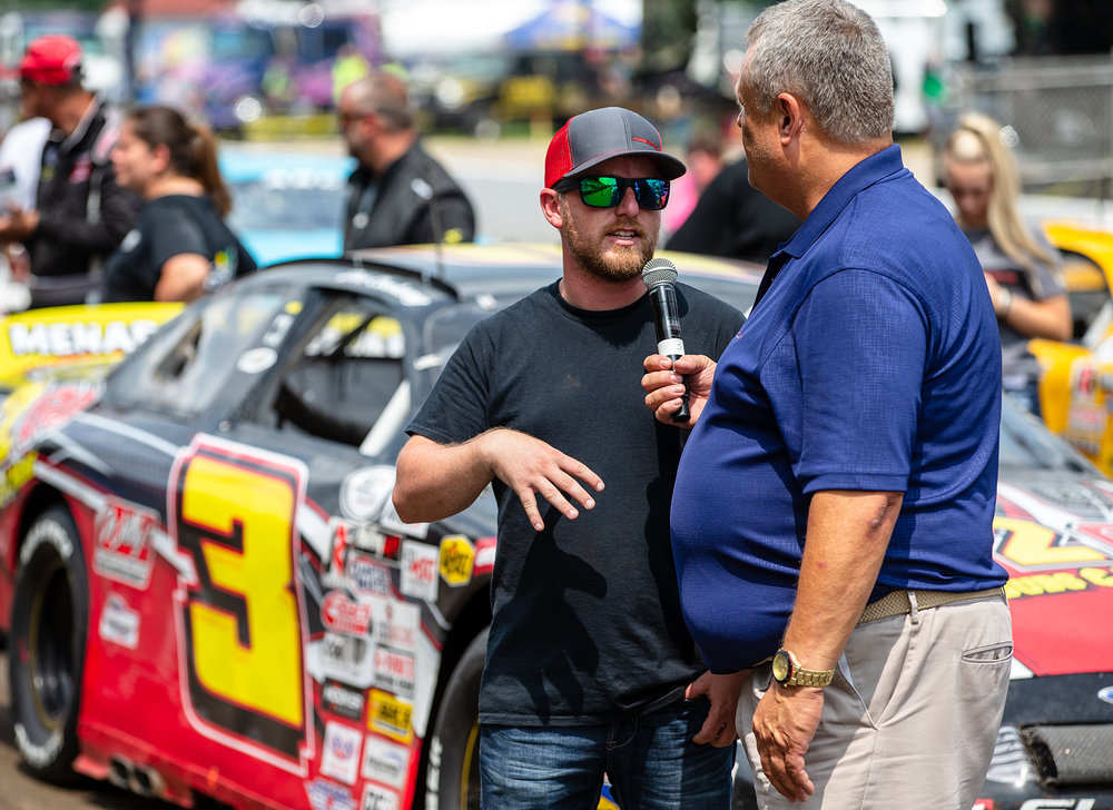 Justin Allgaier gets interviewed for the crowd prior to the start of the ARCA Racing Series Allen Crowe 100 on the Springfield Mile during the Illinois State Fair at the Illinois State Fairgrounds, Sunday, Aug. 19, 2018, in Springfield, Ill. [Justin L. Fowler/The State Journal-Register]