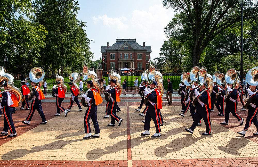 Members of the University of Illinois Marching Illini march past the Illinois Executive Mansion to perform during the dedication ceremony for the new Illinois Realtors Bicentennial Plaza, Sunday, Aug. 26, 2018, in Springfield, Ill. [Justin L. Fowler/The State Journal-Register]