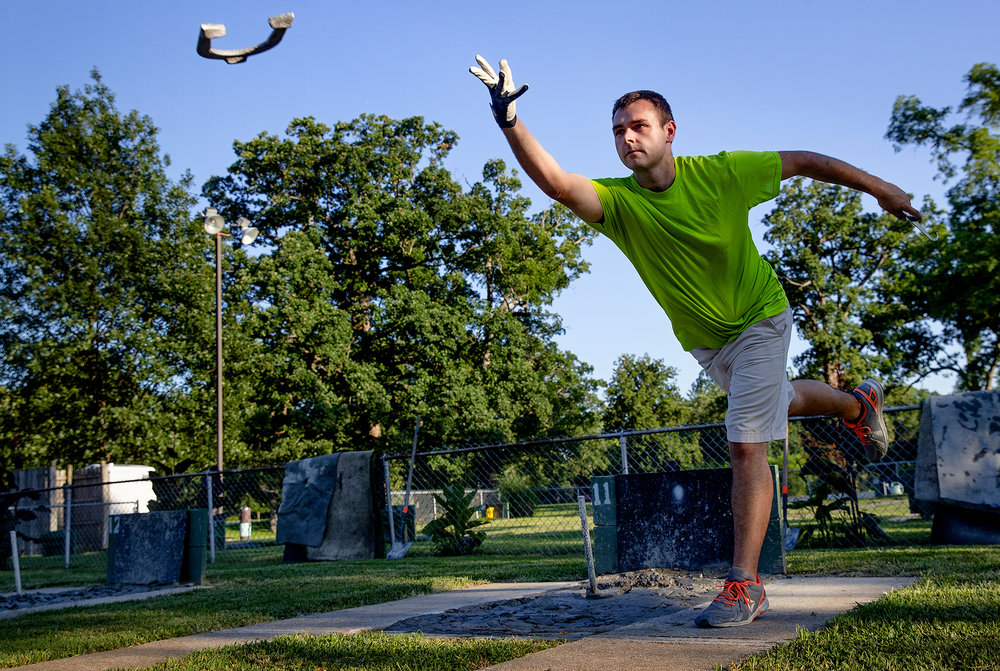 Austin Bailey throws a horseshoe as he warms up before an evening match on the courts in Lincoln Park Tuesday, Aug. 28, 2018. [Ted Schurter/The State Journal-Register]