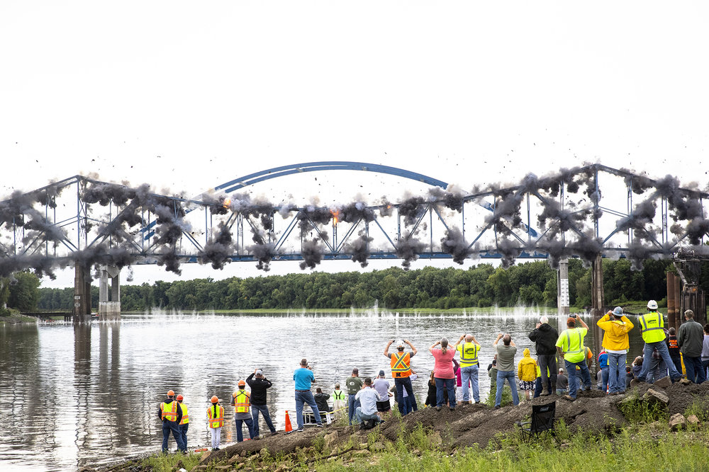 The old bridge carrying Illinois 104 over the Illinois River at Meredosia was imploded Wednesday, Aug. 29, 2018  in Meredosia, Ill. A new span was opened this summer. [Rich Saal/The State Journal-Register]