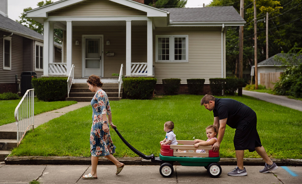 "Hannah and Ryan Jugan take their children Riggs and Willa Rose for a wagon ride in the cooler evening air Wednesday, Aug. 29, 2018. Willa Rose serenaded the family with renditions of ""Twinkle Twinkle Little Star"" while they walked.[Ted Schurter/The State Journal-Register]"