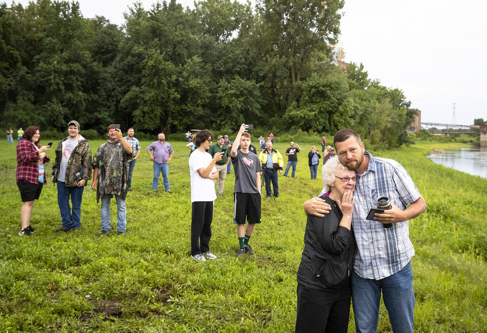 """I didn't think I would react this way, so many memories,"" said Sandra Rasch, after watching the old Meredosia river bridge collapse into the river after being imploded Wednesday, Aug. 29, 2018 in Meredosia, Ill. A lifelong resident of  the river town, she said her dad helped build the bridge, which opened in 1936. A new span was opened this summer. [Rich Saal/The State Journal-Register]"