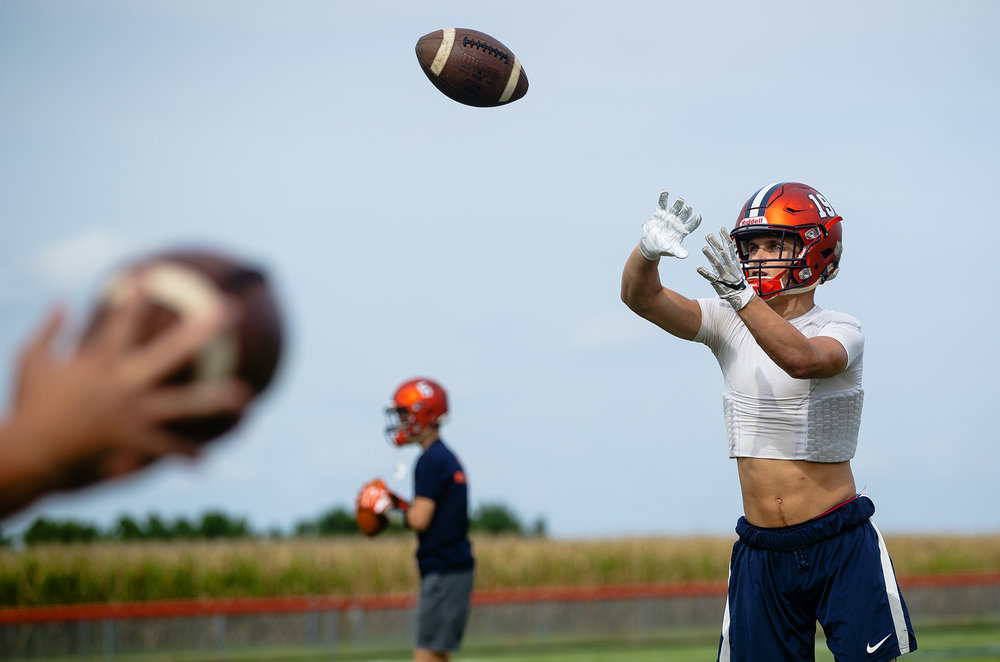 New Berlin's Carson Reese warms up during practice Thursday, Aug. 30, 2018. [Ted Schurter/The State Journal-Register]