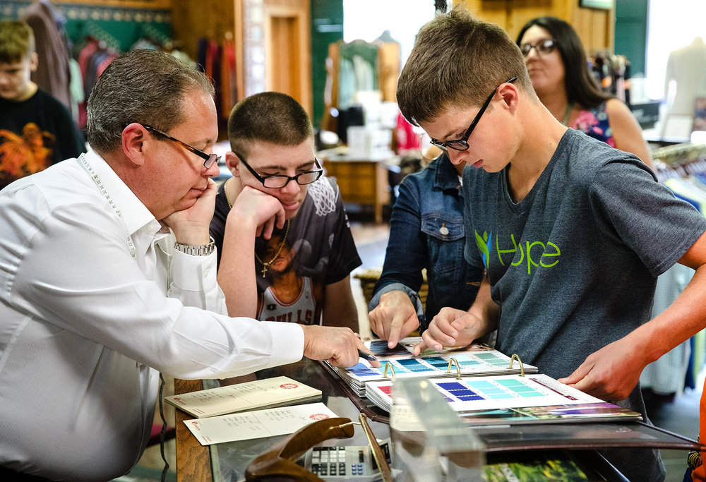Jim Herron owner Marc Maslauski, left, helps Hope students Colin, center, and Brison pick out colors for the tuxedos they'll be wearing during the upcoming 13th Annual Style of Hope Fashion Show. The fundraiser, happening Wednesday, September 12 at the Bank of Springfield Center, will feature men, women and children modeling fashions from stores including Bella Boutique, Cabi, Gypsy Soul, Iris & Ivy, Jim Herron, Ltd, Michael Kors, The Wardrobe, and White House Black Market. [Ted Schurter/The State Journal-Register]