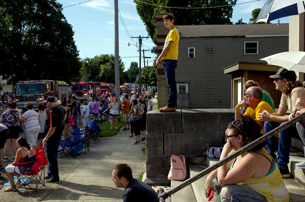 The former Marbold State Bank building provided a high perch to view the parade during the 50th Annual Greenview Labor Day Celebration Monday, Sept. 3, 2018. [Ted Schurter/The State Journal-Register]