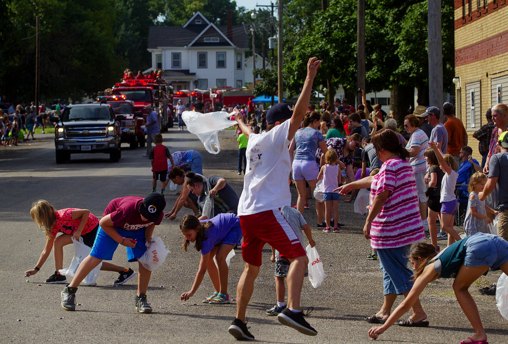Parade goers scramble to collect candy during the 50th Annual Greenview Labor Day Celebration Monday, Sept. 3, 2018. [Ted Schurter/The State Journal-Register]